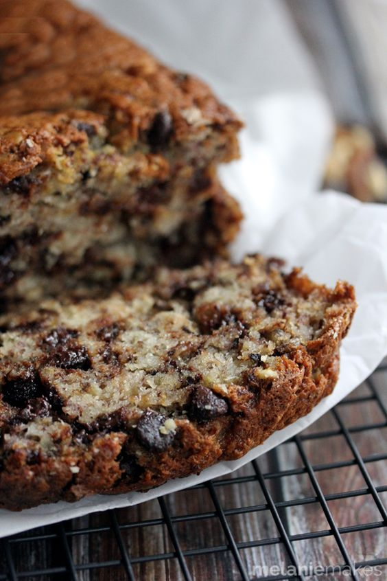 Not one, not two, not three, but FOUR bananas packed into a single loaf of this Chocolate Chip Walnut Banana Bread.  A bread absolutely bedazzled with chocolate chips and walnuts.  It's impossible to take a bite without tasting them both!