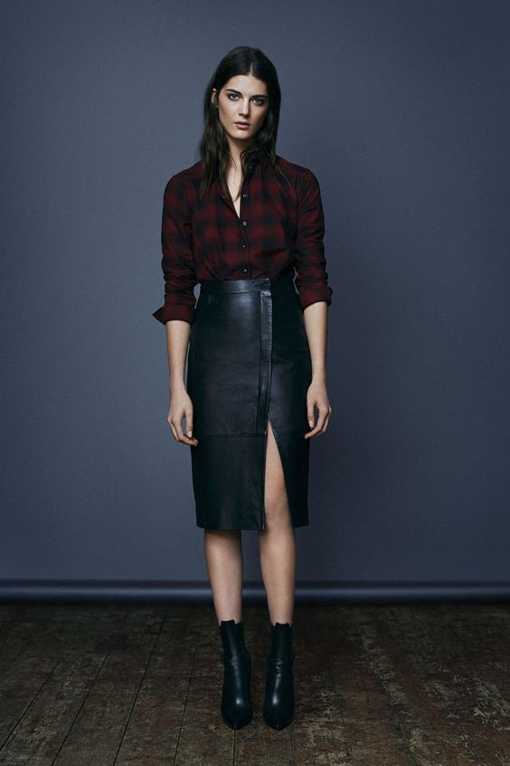 All Saints leather skirt, boots and checked shirt. Great winter outfit.