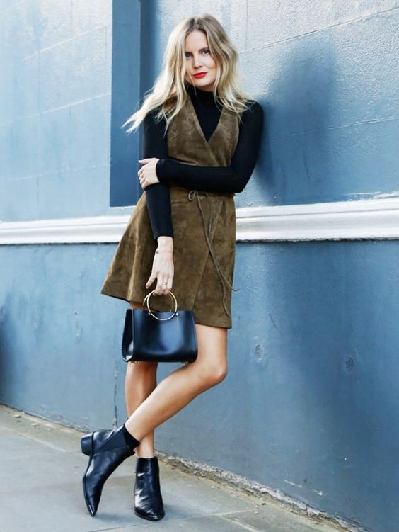 Make a dress winter-ready by layering a black turtleneck underneath.: