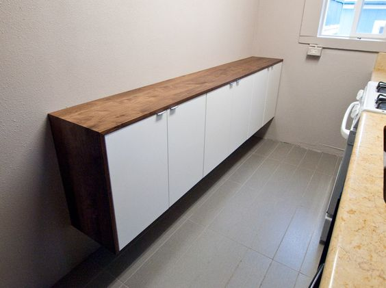Basic Ikea Cabinets That They Covered In This Pretty Dark Wood To Use As Extra Counter Space