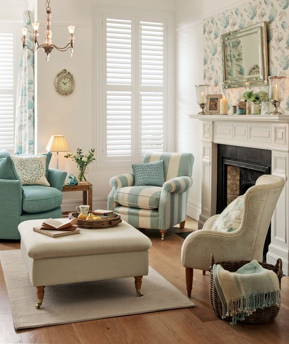 Laura Ashley blue and cream; large floral pattern nicely repeated in a small area. Tailored furniture and stripes keep it from being too sweet.
