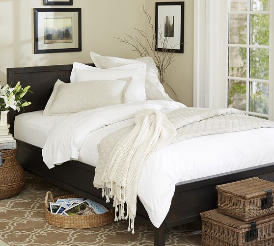 Brown Rug With Pattern, Brown Wicker Baskets, White And