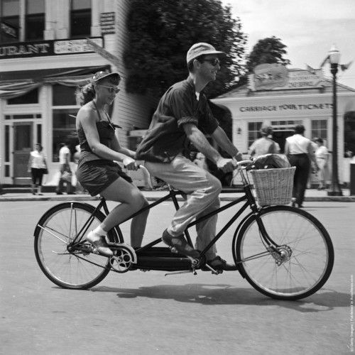 Bicycle built for two, 1955 man in front. Again.