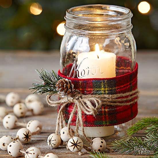 For a Mason jar gift you can make in bulk, try these easy candles. Wrap the jar with wide plaid ribbon. Secure with three jute strings tied in a bow. Hot-glue a pinecone and artificial greenery to the bow. For a final touch, wood-burn a snowflake or polka-dots onto four wooden beads and thread onto four of the string ends. Place a tall, slender pillar candle in the jar./