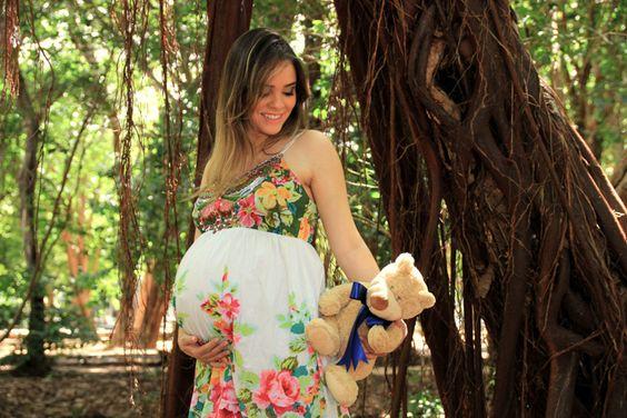 Foto de gestante com ursinho da criança