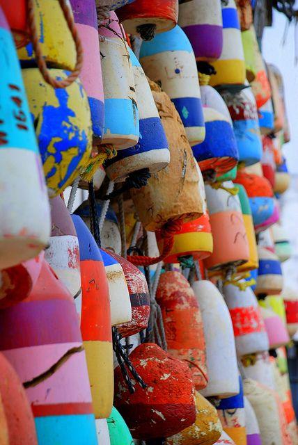 rainbow buoys by the seashore.