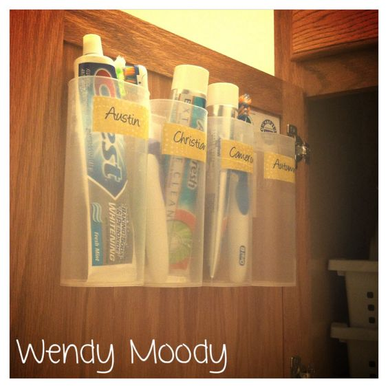 Here's a quick and easy DIY project to get rid of toothbrush and toothpaste clutter on the bathroom counter. I used empty Crystal Light containers and Scotch Multi-Purpose Velcro fasteners. Easy to clean, too!