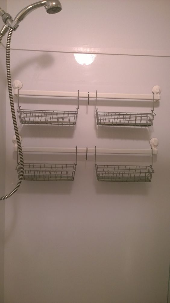 """My new """"Ikea-hacked"""" shower caddy. Made from: Stugvik suction cup towel racks; Bygel hanging baskets; and Grundtal hooks. All items other than the towel racks are found in the kitchen department."""