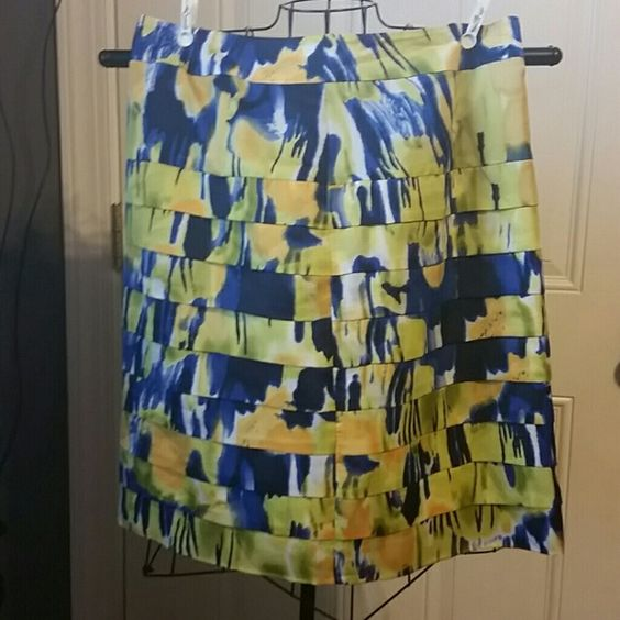 """Calvin Klein tiered Skirt sz 12 Floral Calvin Klein tiered Skirt sz 12 in lime green, yellow, and blue. Excellent Condition from a smoke and pet free home, lined Waist 17"""" Length 22"""" Calvin Klein Skirts Midi"""