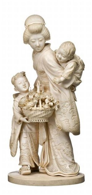 A Tokyo school ivory okimono of a Bijin and two children by… - Okimono - Oriental