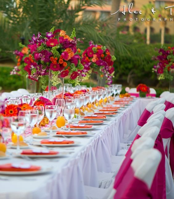 Sunset reception decor theme. Love the combination of colors. http://www.weddingsromantique.com/wp/wp-content/uploads/2013/04/Elegant-Destination-Island-Weddings-table-reception-decorations.jpg: