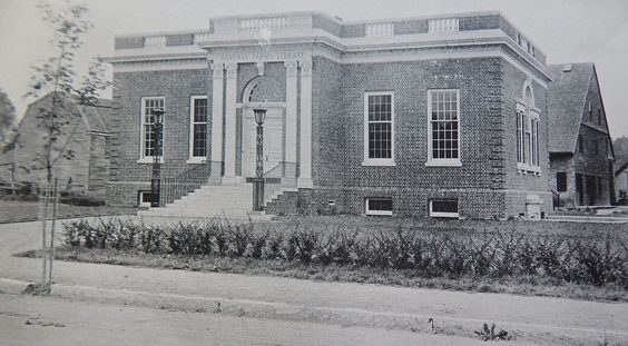 A view of the library from Vine Street in 1916. Notice the dirt road, and the surrounding buildings! The business building behind the library on West Street is still standing today!: