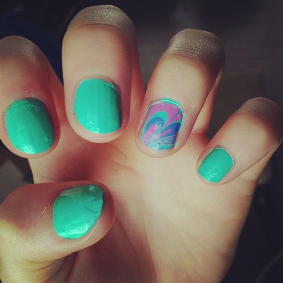 Teal nails with a water colored ring finger :)