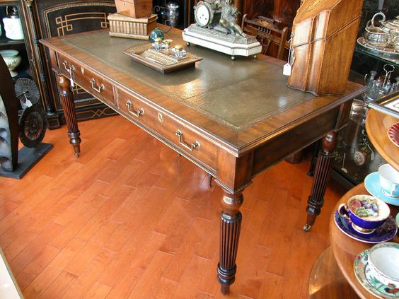 Furniture - Bernardi's Antiques - Toronto | Leather Top Regency Style Writing Desk - Late 19th Century.  $2,200.00 | Large writing surface with 4 turned, reeded legs on castors and 2 drawers - leather top.  circa 1880.