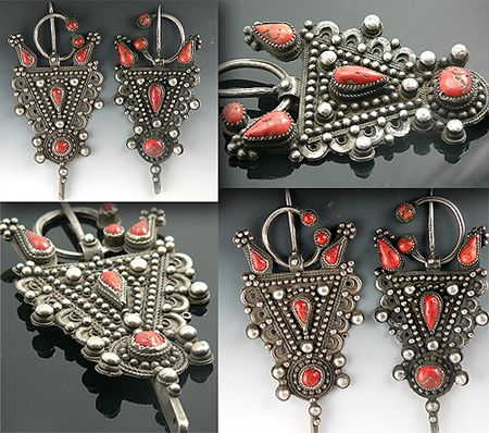 Africa   Pair of silver & coral fibulae. The metal is old coin silver, which is a high silver-content metal derived from melting down old European silver coins. The craftsmanship is traditional Berber.