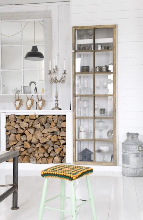 Love the old cabinet door with the white walls