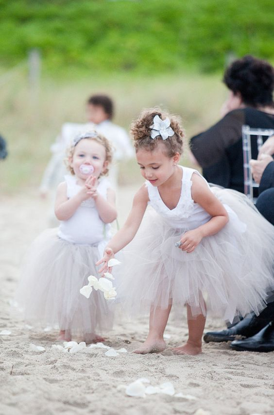 these tutu wearing flower girls look like they are having a grand ol' time  Photography by http://capturedbyjen.com