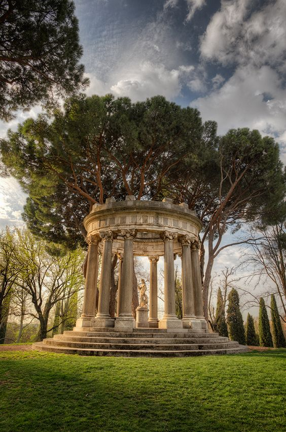 Jardín El Capricho #Madrid #Spain | Though very much unknown and out of the way, the garden of El Capricho (literally, a whim) is one of the most beautiful and attractive parks in the city.  Set on a rise is the temple of Bacchus, which is a classical style garden structure with an oval floor base, surrounded by twelve Ionic columns, making it a romantic view from other parts of the garden