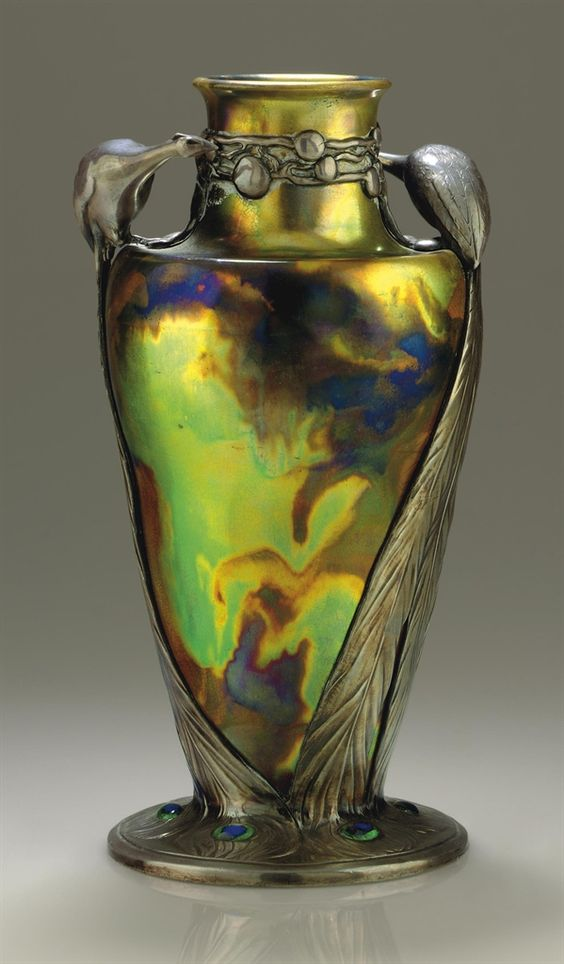 CONTINENTAL -  A PEWTER-MOUNTED IRIDESCENT GLAZED CERAMIC VASE, CIRCA 1900:
