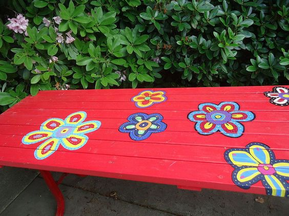 Out with the old standard of plain wooden picnic tables and in with the added POP of colour and vibrancy! Beautiful and would be a great project to get the kids involved in!