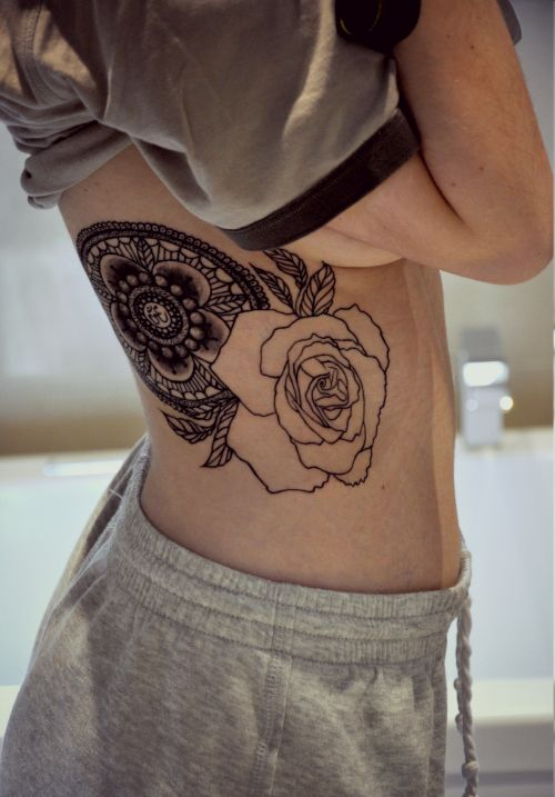 An intricate mandala accompanied by an outline of a rose to symbolize wholeness, balance and new beginnings. The Om symbol represents an infinitely open mind, which I always try to have. Done by Maxime at Mauve Montreal