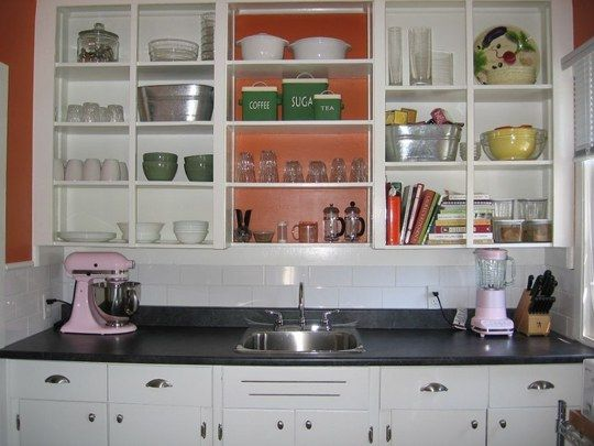 @Carolyn Lyons - this is clean and cute. I like the idea of removing the cabinet doors, but it would have to be in the right location and if the stuff inside the cabinet was pretty.