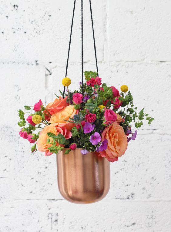 This on trend copper planter is perfect for blooms this spring. Shop our bright bouquet full of roses and craspedia and place in the planter using oasis for a stylish addition to your room. Flowers at £29 with free next day delivery.