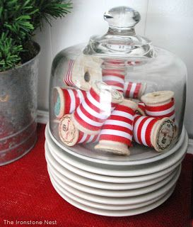 Vintage spools wrapped in red and white striped ribbon ~ Tour of Our Nest – Christmas Style