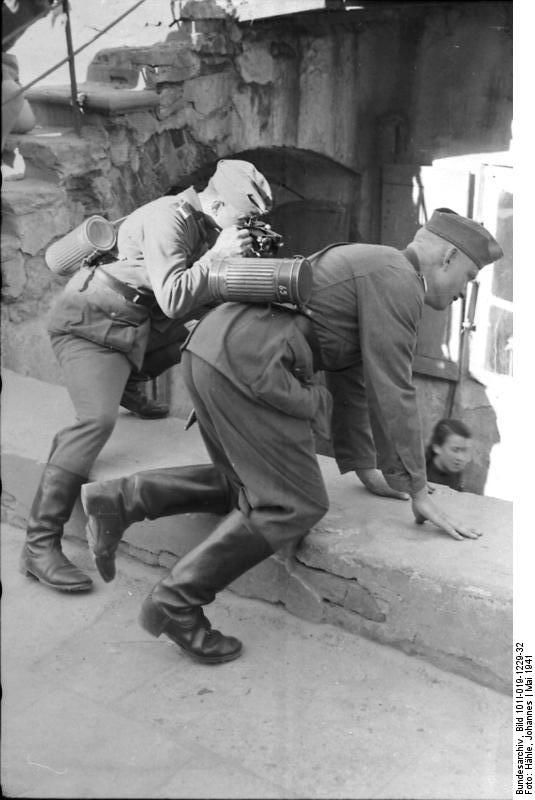Two German soldiers taking a shot in Lublin. Poland 1941.