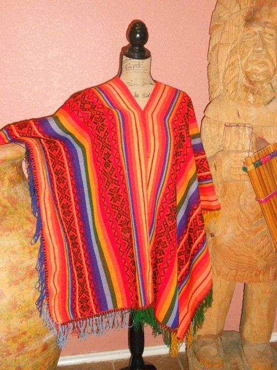 Earth and rainbow Celebration Peruvian Wool poncho/cape, One size fits most $129.00  @Aspenandes Handcrafts Handcrafts