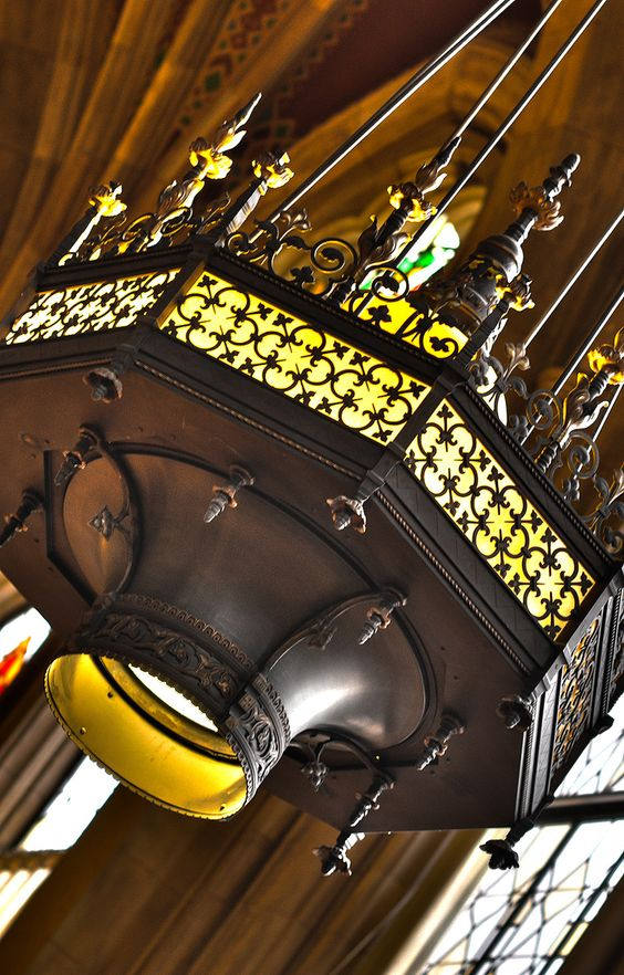A fixture hangs from the ceiling to shed light in the Suzzallo reading room. #youW Photo by John Manuel