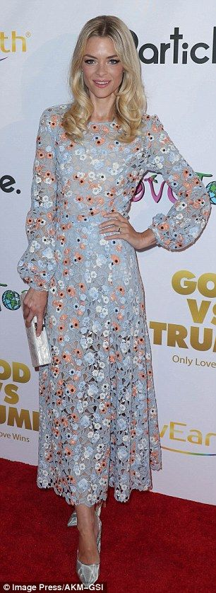 Looking good: The 37-year-old model sported a blue floral patterned long-sleeved maxi dres...