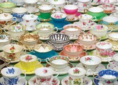 "From Havilland to Limoges: Tea Cups Puzzle  A myriad antique teacups marry together upon a puzzle that is a joy to piece together. Museum gift shop quality cut from premium blue board for the most fickle of puzzle enthusiasts! 1000 pieces. USA. 27 x 19"".     #i22389"