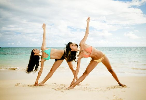Wear a bikini, make some flower necklaces with your friend and do yoga by the beach. Because friendship.