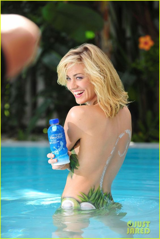 "Body painted in palms and coconuts, ""Chuck"" Actress Yvonne Strahovski turns up the heat to launch the new SoBe Lifewater with Coconut Water"