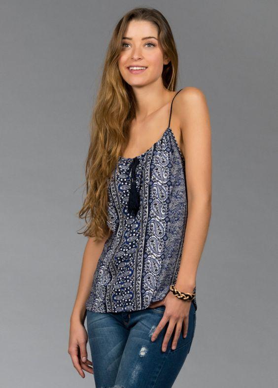 Blusa de Tirantes con detalle de flecos en el pecho y estampado tribal 100% Viscosa La modelo viste talla chica. Medido en talla chica.  Código del producto:1