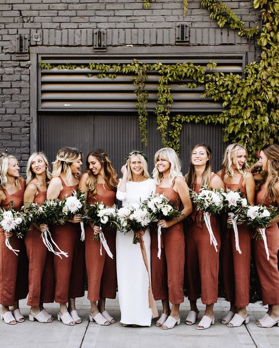The look is fashion-forward, versatile, and flattering—plus, the pants component of these garments allows your crew to move freely on the dance floor. #wedding #bridesmaids #weddingfashion #jumpsuits #weddingparty #weddingideas #weddings #highfashion #weddingtrends | Martha Stewart Weddings -  20 Wedding Parties That Prove Bridesmaids' Jumpsuits Are Just as Beautiful as Dresses