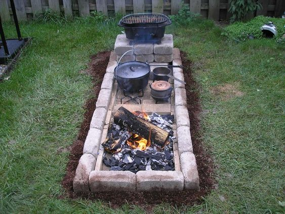 Hearth Cooking Complex with a firebox on one side and a cold area for staging cooking prep on the other side.  I want!  Link to directions for building - https://www.facebook.com/groups/castironskillet/738259676257870/