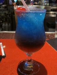 Snow Cone: DeKuyper® Watermelon Pucker®, Malibu® Coconut rum, Three Olives® Cherry vodka, Blue Curacao, Sprite® and pomegranate syrup over shaved ice. (From Dave and Buster's.)