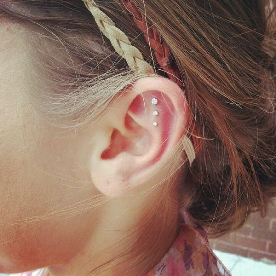 Triple ear piercings. I love how they are perpendicular to the ground