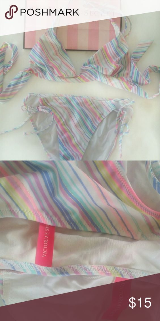 Victoria's Secret Bikini size M (top) & XS (bottom Victoria's Secret Banded Triangle Top (size medium) and  Victoria's Secret The Bow Bikini bottom in a matching white with pink and blue striped print in size extra small.  This suit has been worn, but it still has life - and no rips, snags, or stains.  The removable pads from the top have been removed and are not included.  Top ties around neck and back, bottoms tie at sides. Victoria's Secret Swim Bikinis