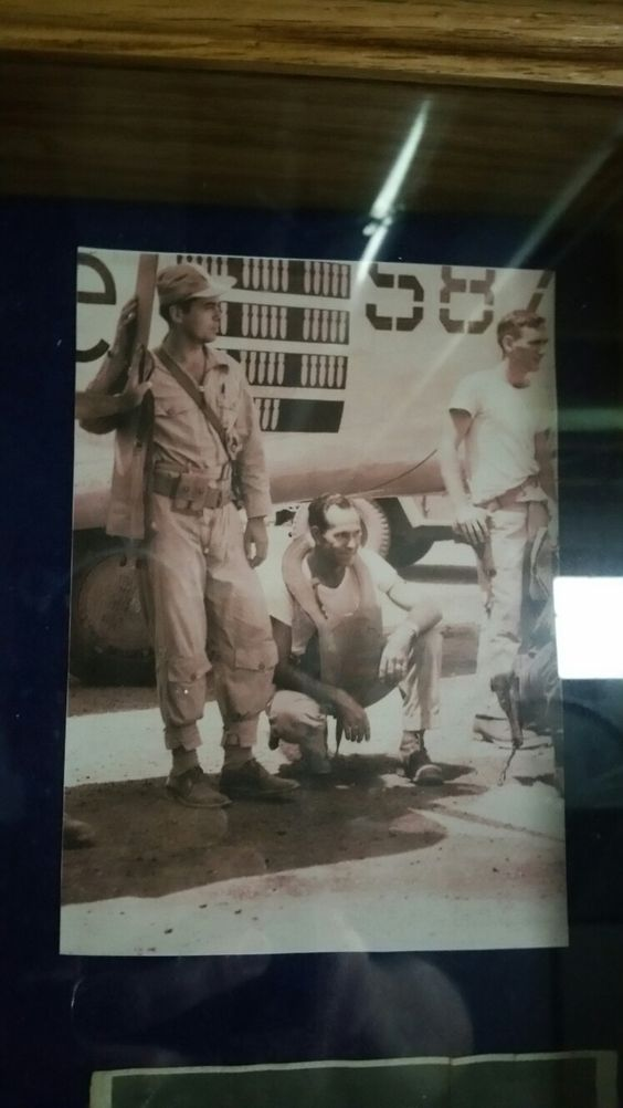 My Grandfather and crew by their B24D Liberator in the South Pacific during WW2.