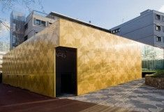 Perforated aluminium panels, gold finish, Maison du Portugal by RMIG, architecture at STYLEPARK