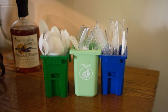Trash cans to hold the spoons, knives, and forks for the guests at the Garbage Truck Birthday Party.