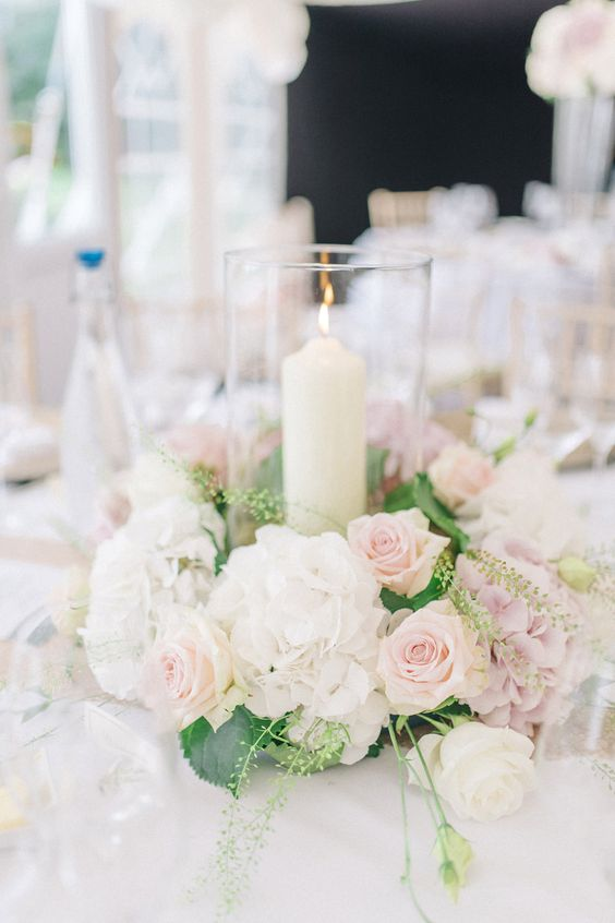 Hurricane Vase surrounded by White Hydrangeas & Pink Rose Floral arrangement | Pastel pink, Mint Green & White Colour Scheme with Gold Accents | Stately Home Country Wedding Venue | Outdoor Ceremony | Marquee Reception | Photography by Sarah-Jane Ethan | http://www.rockmywedding.co.uk/simone-tim/