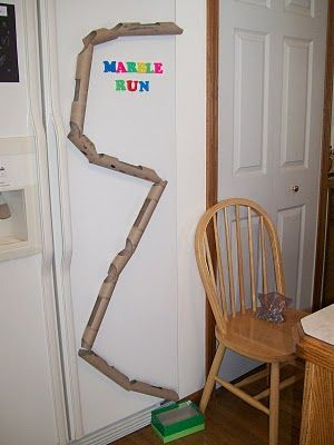 Using paper toilet rolls or paper towel rolls or both create a marble run.  For teachers in the classroom create it so that kids do not have to climb on the chair.  Safety first.: