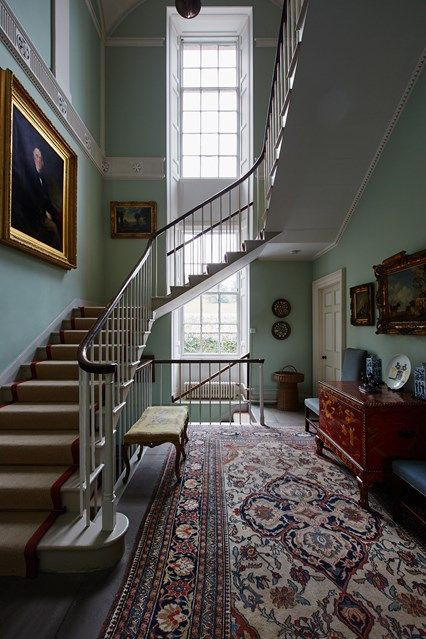 Spiral? Floating? Discover staircase design ideas on HOUSE - design, food and travel by House & Garden, including this hallway brightened duck egg blue walls