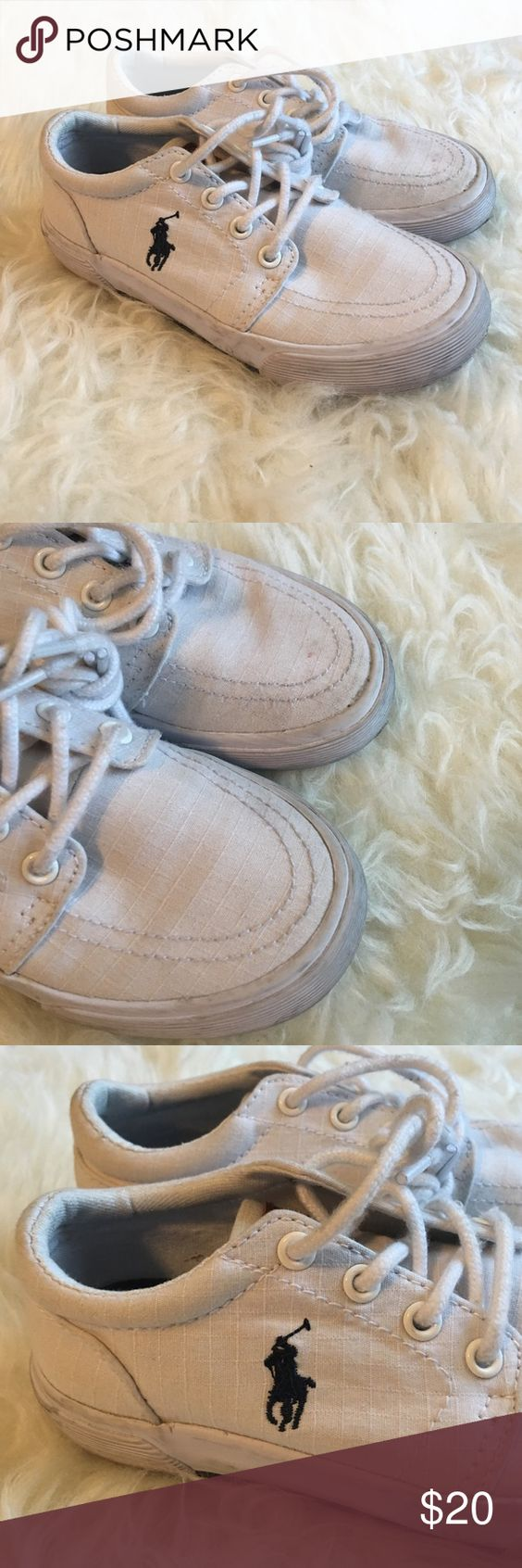 Polo Ralph Lauren Kids Sneakers White Classic Sneakers featuring lace up closure, brown Polo tag on tongue and Signature Blue Polo Icon on outer side of both shoes. Some normal scuffing and wear on sides and toes but in great condition Polo by Ralph Lauren Shoes Sneakers