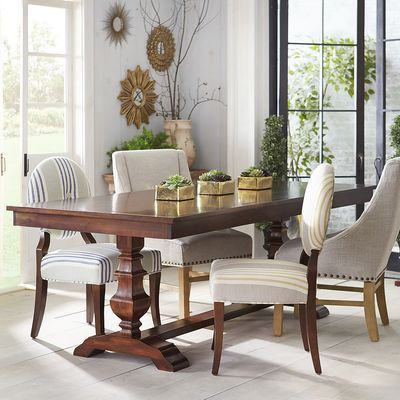 Traditional meets subtle rustic for casual or formal dining. Crafted with hardwoods, our handsome Bradding table comfortably seats up to eight and features a rich, espresso finish and urn-shaped trestle legs. Exclusively Pier 1.