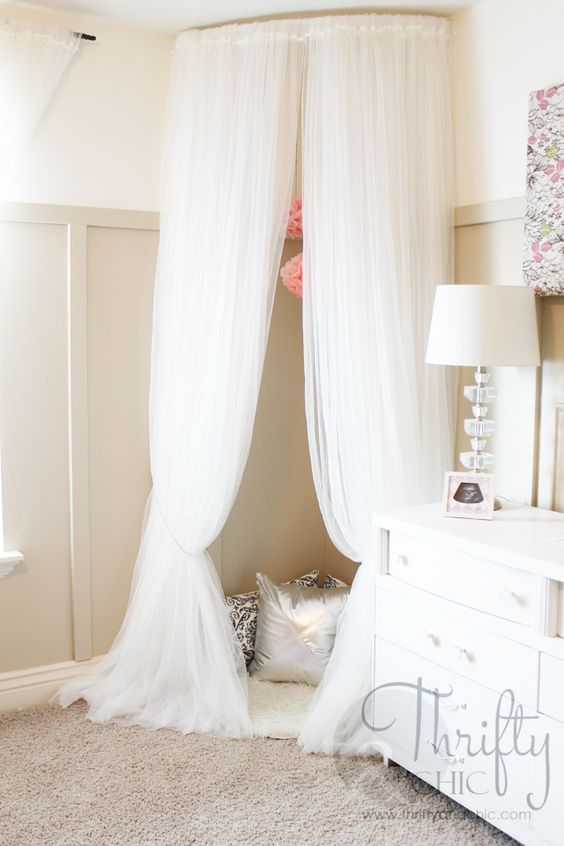 Whimsical Canopy Tent or Reading Nook made from curved curtain rod and $4 ikea curtains: